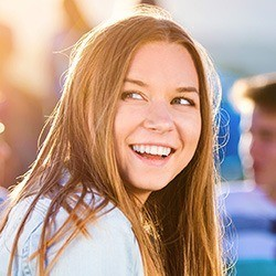 Teen sharing healthy smile after orthodontics