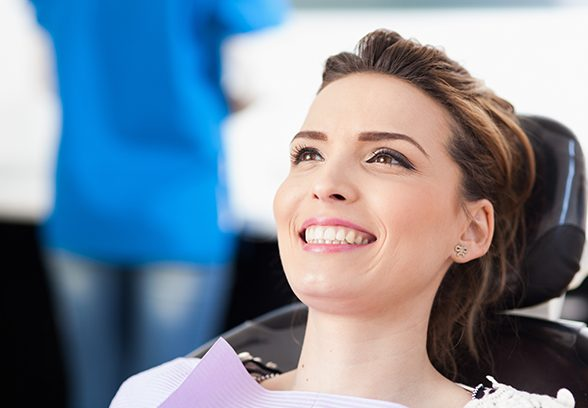Woman smiling during preventive dentistry exam