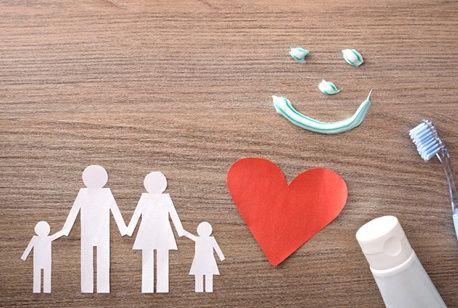 a paper cutout of a family and a heart