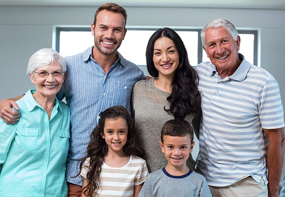 Three generations of family with healthy smiles thanks to preventive dentistry